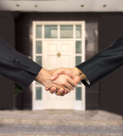 shaking: Estate agent sells the house and shaking hand of client Stock Photo