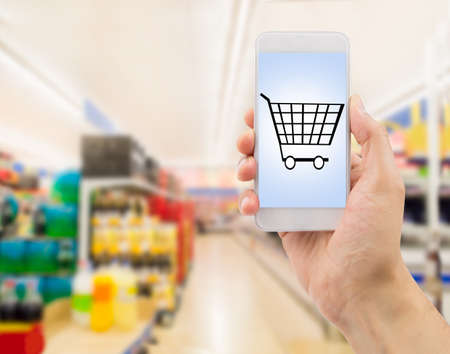 wacom: Closeup of hands using smartphone in supermarket .screen content is designed by us and not copyrighted by others and created with wacom tablet and ps Stock Photo