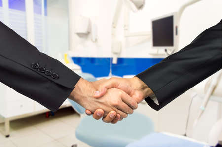 odontology: partners in agreement in the odontology business Stock Photo