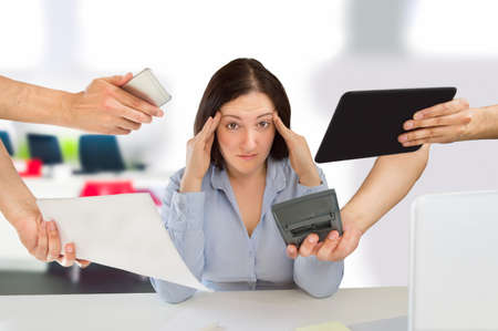 job deadline: business woman overwhelmed with so much work
