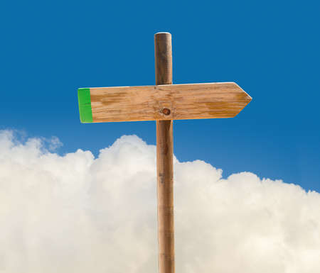one lane road sign: arrow on signpost indicating the correct path in blank with clouds and sky on background