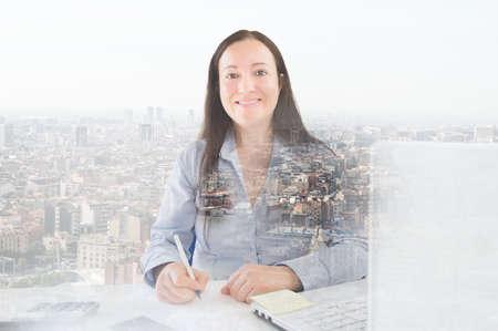 superimposed: businesswoman superimposed over a cityscape