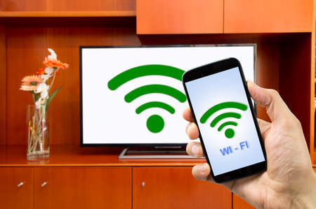 connectivity between smart tv and smartphone through wifi connection. All screen content is designed by us and not copyrighted by others and created with digitizing tablet and image editor Stok Fotoğraf - 46067135