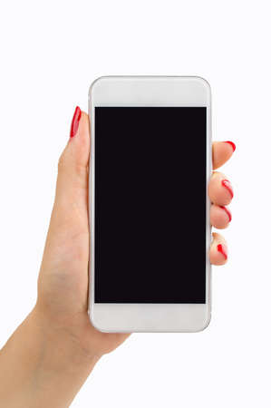female hand holding a smartphone with painted nails manicure in red Imagens