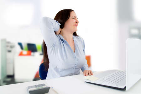 exhausted worker: working with neck pain in the office
