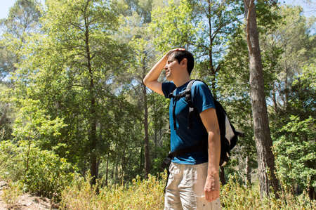 Dehydration thirst heat stroke exhaustion concept with man hiker tired Stock Photo