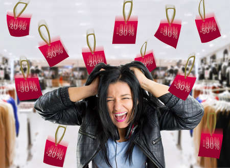 thirty percent off: very crazy woman with rain bargain prices in the store.  Stock Photo