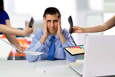 business man overwhelmed with so much work Stock Photo
