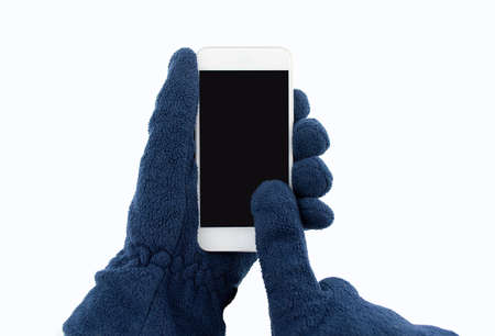 closeup of man with gloves using the smartphone