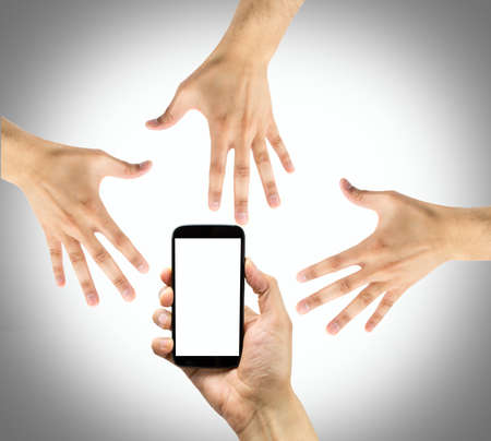 important phone call: Group of hands grabbing an old phone with gray background Stock Photo