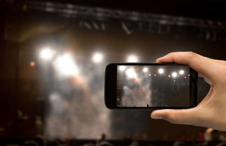 man filming a concert with your mobile phone No person Reklamní fotografie