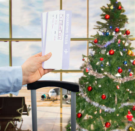 transportation travel: close up of woman showing banknotes in an airport on Christmas