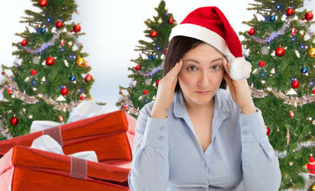 Stressed woman shopping for gifts of christmas with red santa hat looking angry and distressed