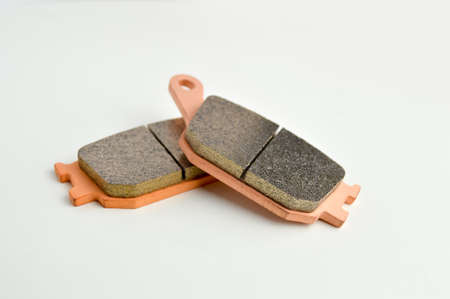 two automotive brake pads isolated on white background