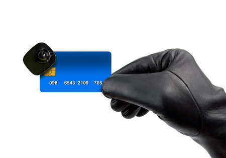 cardkey: hand with glove of thief holds the credit card with electronic alarm over white background