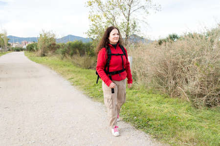 fleece: woman hiker hiking in forest walking on the trail