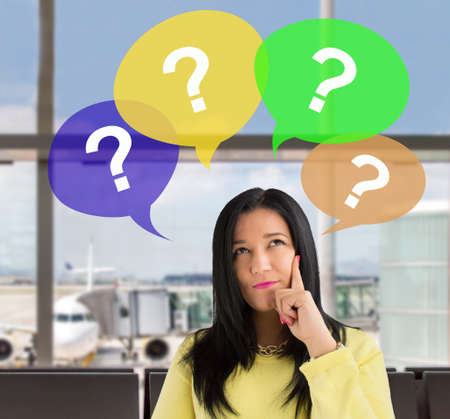 ps: woman having questions at the lobby of the airport. All screen content is designed by me and not copyrighted by others and created with wacom tablet and ps Stock Photo