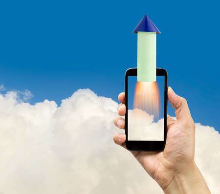 disruptive: rocket launching from smartphone. Start up business concept for mobile app development or other disruptive digital business ideas and connection speed