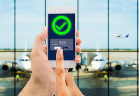copyrighted: hand is entering password to buying flight tickets online. All screen content is designed by us and not copyrighted by others and created with wacom tablet and ps
