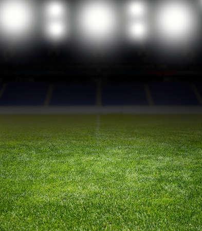 soccer: Green soccer field row of bright spotlights illuminated stadium in night Foto de archivo