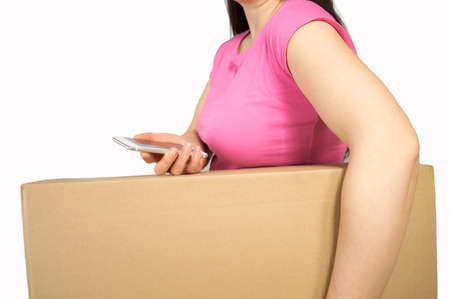 mobile communication: detail of a woman with a box and calling by phone for a carriage company on white background
