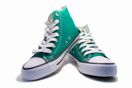 a pair of green vintage shoes isolated on white background