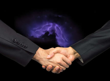 negative equity: Handshake with storm background in business concept canceled
