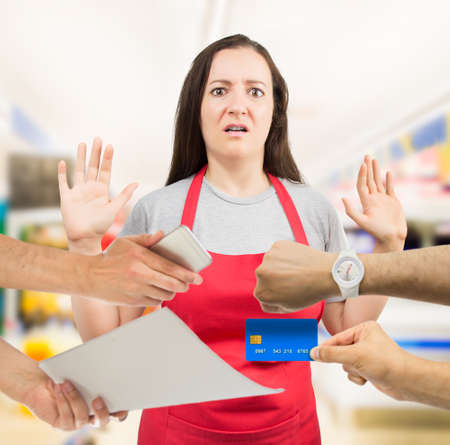otras palabras clave: saleswoman with overworked at the supermarket Stock Photo