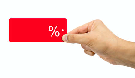 Man holding discount red label with percent sign in hand with sale concept and white background