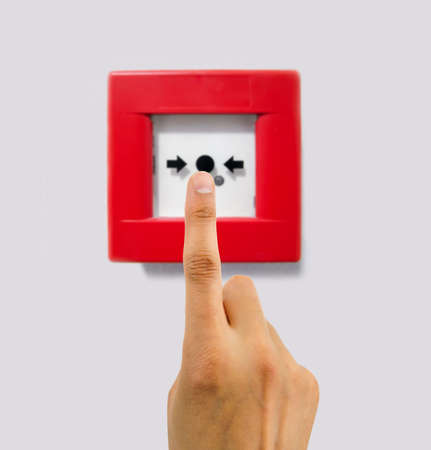 activate: A hand of man standing over the alarm lever to activate it Stock Photo