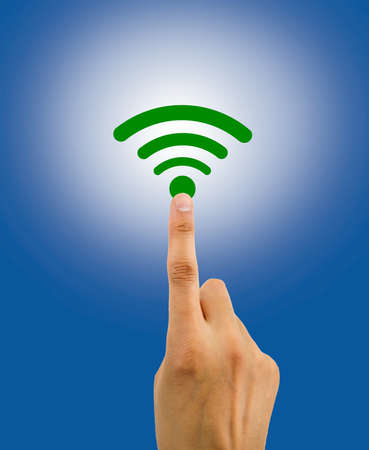 jamming: hand pushing the wireless icon with great coverage on a blue background. All screen content is designed by my and not copyrighted by others and created with digitizing tablet and image editor Stock Photo