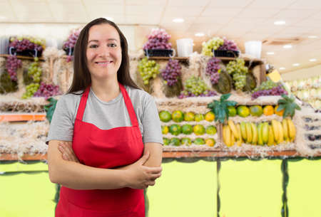 female portrait: portrait of saleswoman at the fruits store with crossing arms Stock Photo
