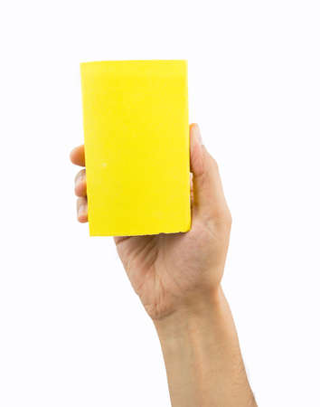 sanding block: hand showing yellow sandpaper isolated on white background