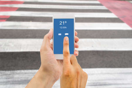 distraction: hands crossing a crosswalk using the smartphone like a concept of distraction and risk of abuse of smartphone use