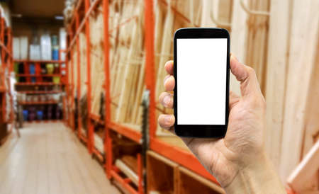 handyman shopping online wood with the smartphone