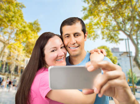 rambla: happy couple taking selfie picture in a travel at the rambla Barcelona Spain Stock Photo