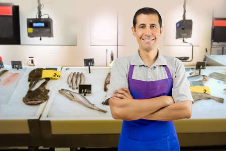 fishmonger: fishmonger smiling and looking at camera arms crossed Stock Photo