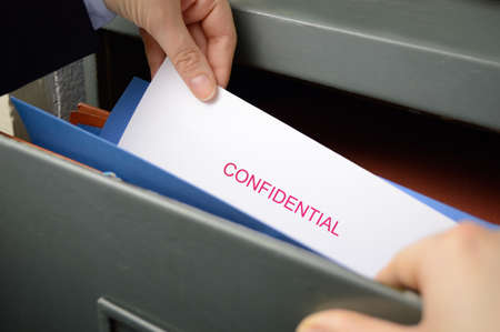 spy stealing confidential files in an office