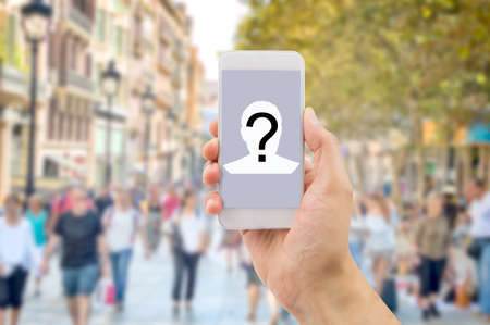 wacom: Mobile concept question man hands holding a mobile phone screen with a question mark in a big city background. All screen content is designed by me and not copyrighted by others and created with wacom tablet and ps Stock Photo