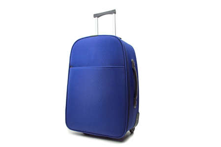 carryall: blue travel suitcase standing over white background
