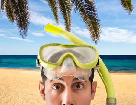 Beach vacation surprised man wearing a snorkel scuba mask making a goofy face. Closeup portrait of man on her travel holidays