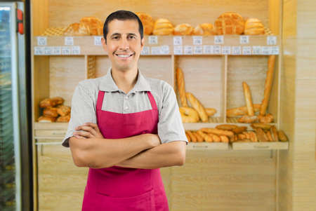 selling service: Portrait of an man working in a bakery