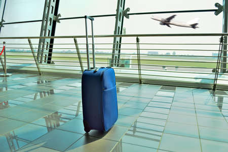hand luggage forgot at the airport lobby Stock Photo