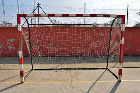 center court: soccer and handball center court and red and white goal