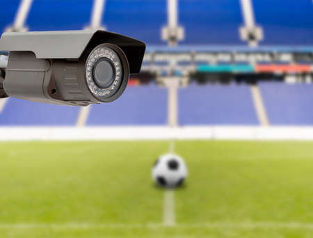 warning fans: CCTV security camera on the roof of the stadium Stock Photo
