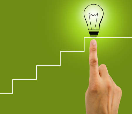 copyrighted: hand is touching the bulb at the final of stairs as concept of creation of a genial idea. All screen content is designed by my and not copyrighted by others and created with digitizing tablet and image editor Stock Photo