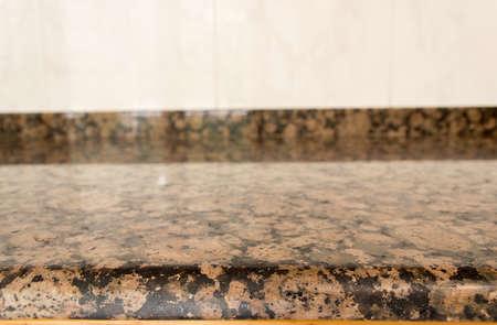granite kitchen: closeup of granite counter at a domestic kitchen