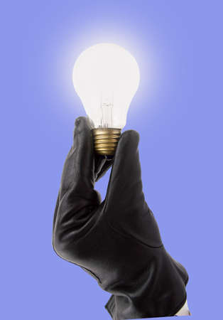 crime solving: hand with black gloves holding the lightbulb on as concept of thef of ideas on blue background