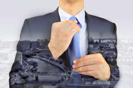 superimposed: unrecognizable businessman superimposed over a cityscape in black and white