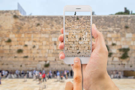 western wall: tourist man taking photo with the smartphone at western wall of jerusalem israel Stock Photo